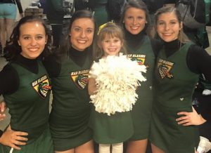 My granddaughter, Aly, proudly pictured with UAB Cheerleaders