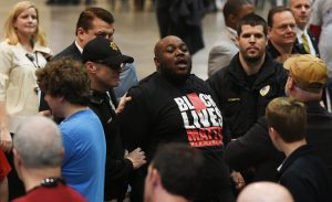 Mercutio Southall Jr., being escorted out of Donald Trump rally in Birmingham