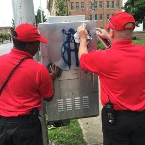 CAP Officers removing graffiti